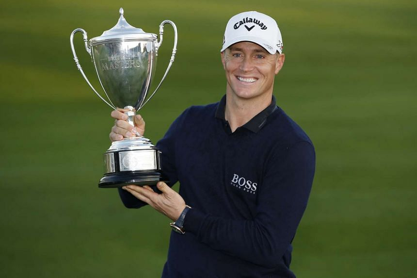 Sweden's Alex Noren celebrates winning the British Masters with the trophy.