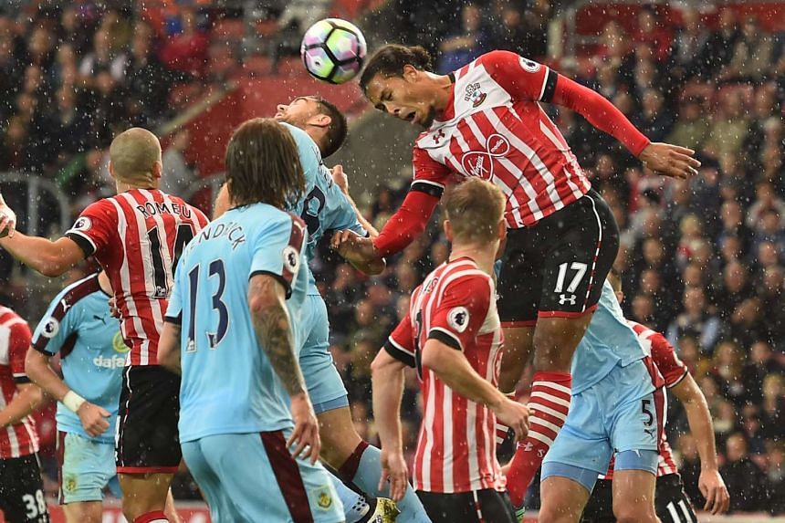 Southampton's Dutch defender Virgil van Dijk (right) heads the ball during the English Premier League football match between Southampton and Burnley at St Mary's Stadium in Southampton, southern England on Oct 16, 2016.