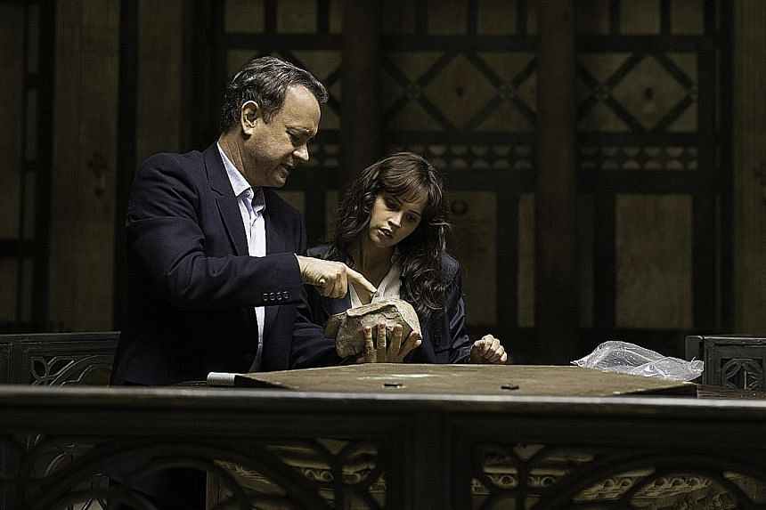Tom Hanks and Felicity Jones (both above) have to solve a series of clues to save Earth.