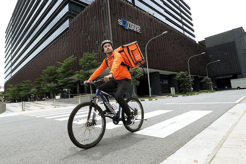 Mr Fazli, a Foodpanda cyclist, says riding a bicycle is more flexible as he can use the pavement to avoid traffic.