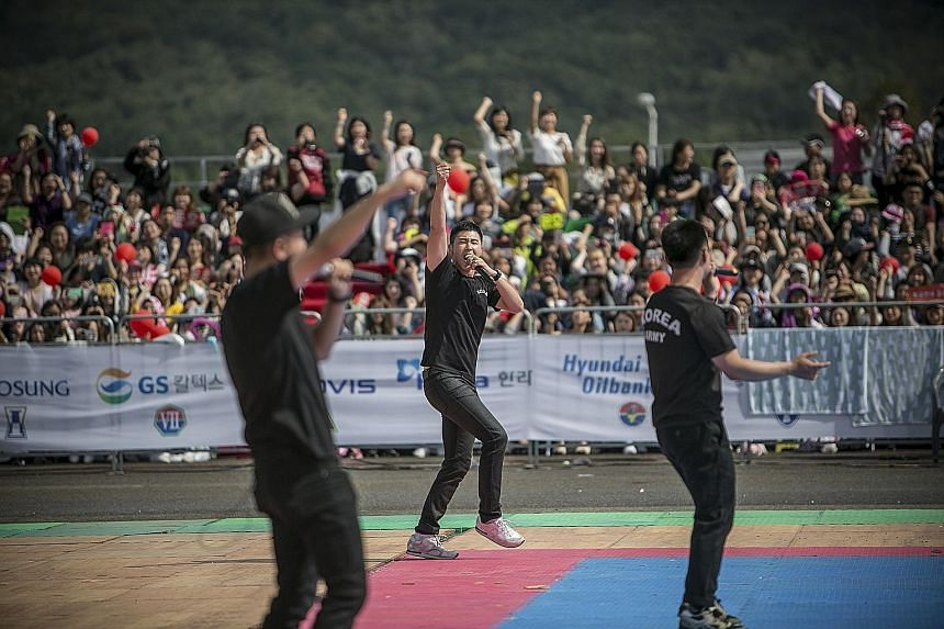 U-Know Yunho (centre), a soldier and one of South Korea's most famous K-pop stars, performing at a military festival.