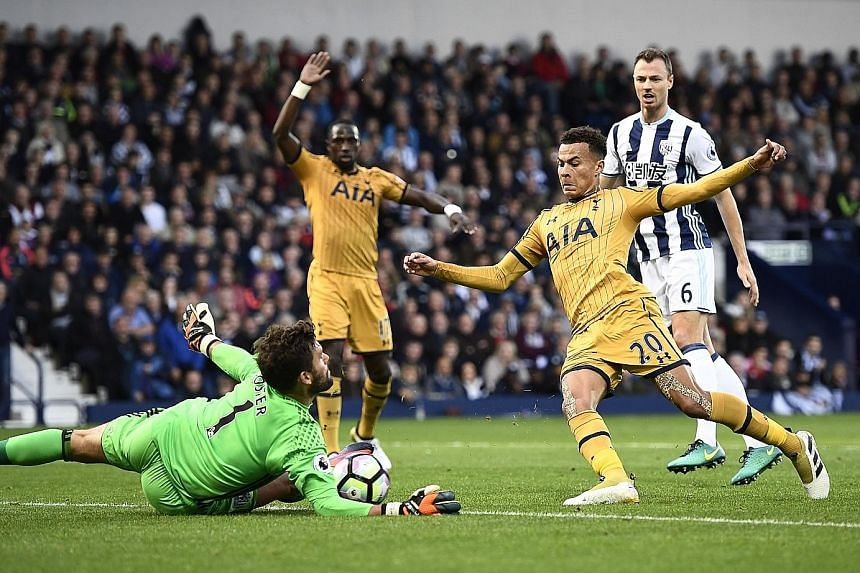 West Bromwich Albion goalkeeper Ben Foster makes a save from Tottenham's Dele Alli (No. 20). But Foster was beaten by the midfielder late in the game as the sides drew 1-1.