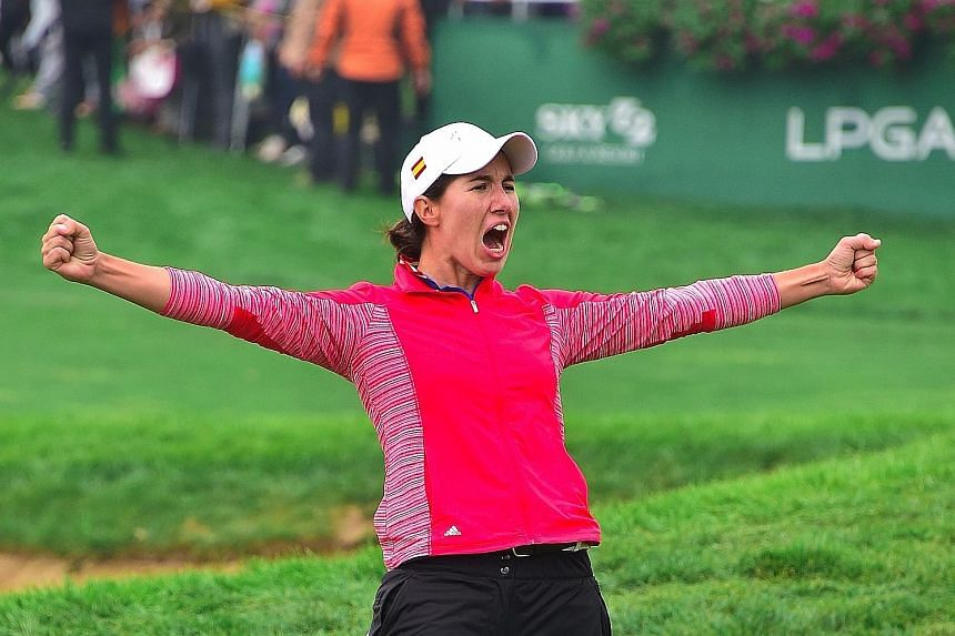 Carlota Ciganda of Spain celebrates her maiden Tour victory on the first play-off hole at the LPGA KEB Hana Bank Championship golf event at the Sky72 Golf Club.
