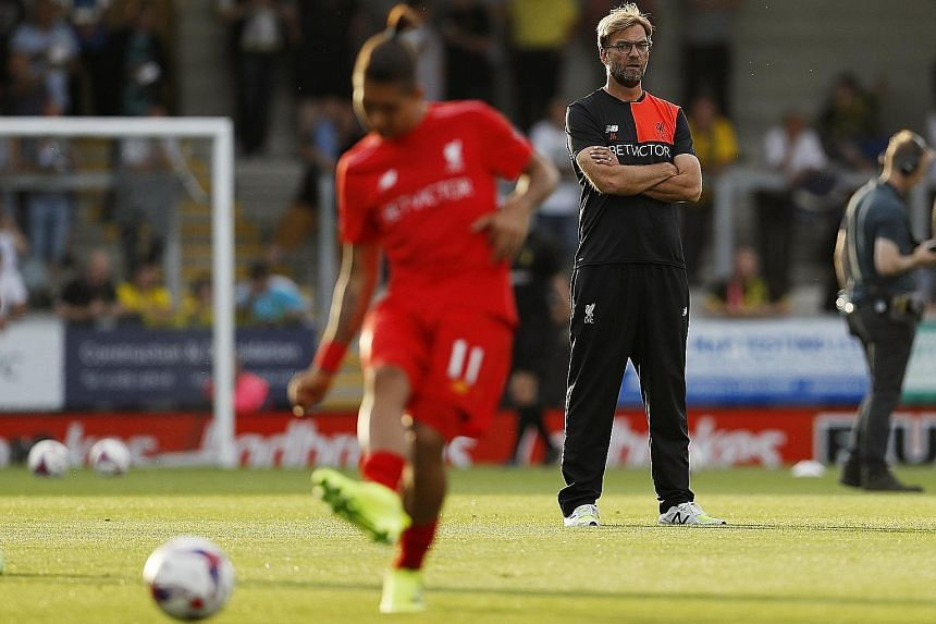 """Jurgen Klopp is pragmatic about Manchester United's physical strength and says: """"All we can do is try to avoid situations where they can use it. But we have strengths of our own and first we must concentrate on what we do well."""""""