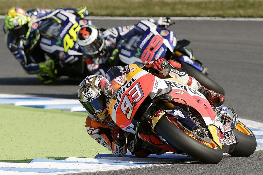 Above: Honda rider Marc Marquez, winner of the Japanese Grand Prix in Motegi, had never won at Honda's home circuit before yesterday's race. Left: Marquez leading Italian MotoGP Yamaha duo Valentino Rossi (left) and Jorge Lorenzo during the Japanese