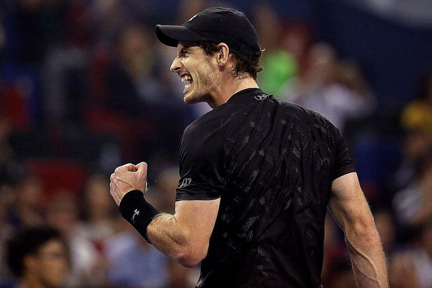World No. 2 Andy Murray, who won the Shanghai Masters in 2010 and 2011, shows his delight at winning the title for a third time yesterday after beating world No. 19 Roberto Bautista Agut 7-6 (7-1) 6-1.