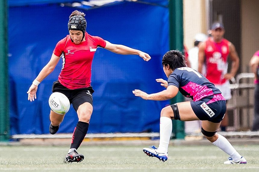 Singapore women's captain Alvinia Ow Yong (left) in action against Japan in the Hong Kong leg of the Asia Rugby Sevens Series last month. Japan won that match 45-0 and went on to be crowned series champions.