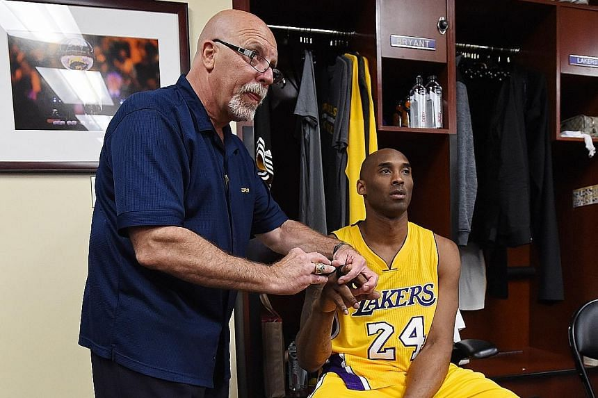 Former Los Angeles Lakers physiologist Gary Vitti giving Kobe Bryant treatment on his right hand before a game in April this year.