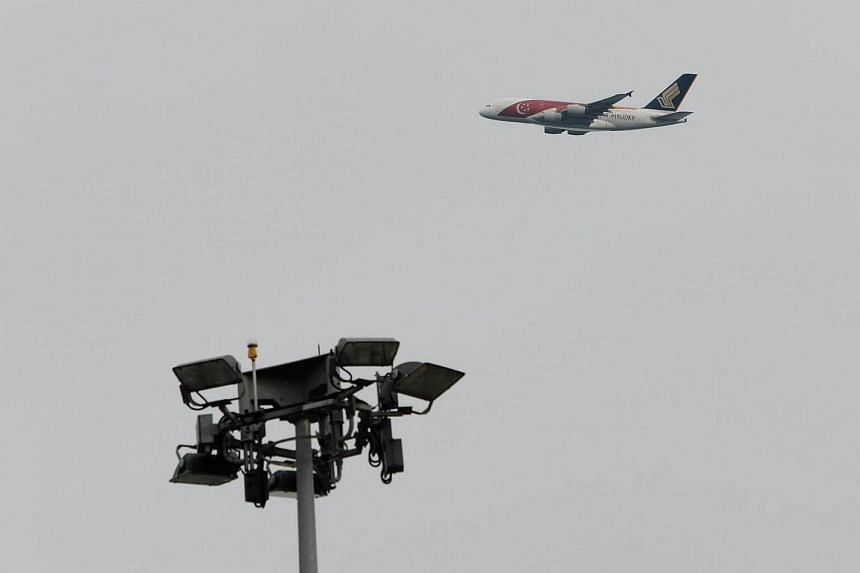 A Singapore Airlines plane seen above Changi Airport on October 16, 2016.