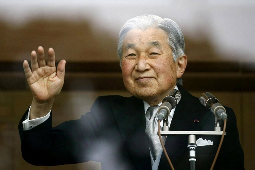 Japan's Emperor Akihito waves to well-wishers who gathered at the Imperial Palace to mark his 82nd birthday in Tokyo, Japan on Dec 23, 2015.