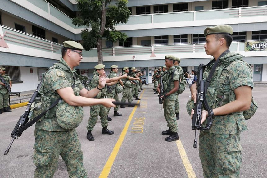 SAF personnel going through a refresher course on the use of batons, as part of an islandwide counter-terrorism exercise, at Lim Chu Kang Camp on Oct 17, 2016.