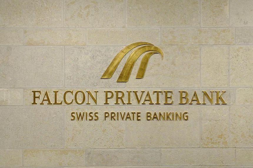 The logo of the Swiss Falcon Private Bank is pictured late on Oct 13, 2016, at the Falcon headquarters in Zurich.