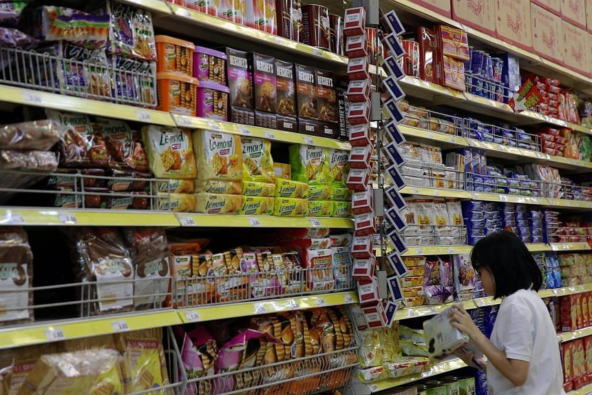 A woman shops for groceries at Giant Tampines.