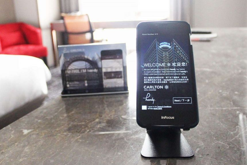 "Guests at Carlton Hotel Singapore can enjoy connectivity throughout their stay with the ""Handy"" device installed in its hotel rooms."