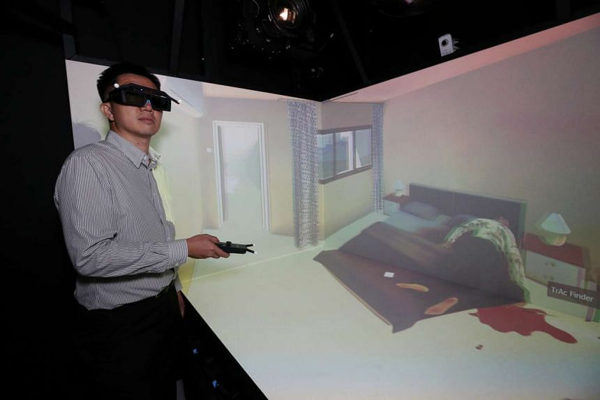 A trainee uses the semi-immersive system to investigate at the crime scene at Human Performance Centre.
