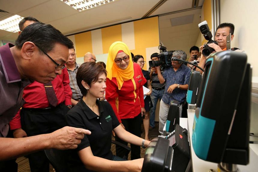 Senior Minister of State for Transport Josephine Teo tests training equipment during the launch of the new Singapore Bus Academy.