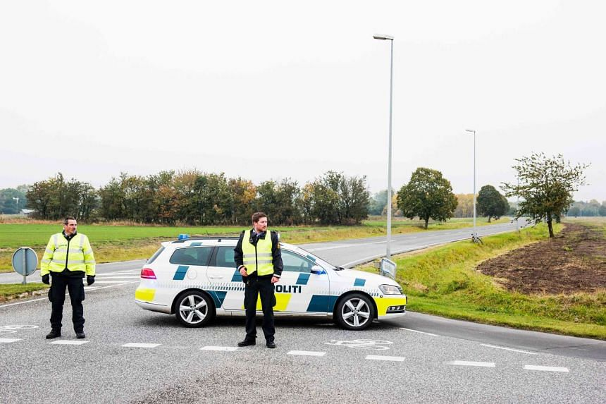 Policemen block a road leading to the Roskilde airport in Roskilde, Denmark on Oct 17, 2016.