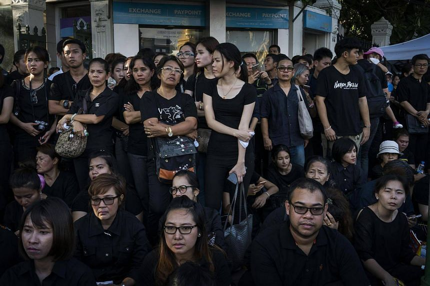 Mourners congregate to pay their respects outside the Grand Palace, where the remains of King Bhumibol Adulyadej lie, in Bangkok on Oct 15, 2016.