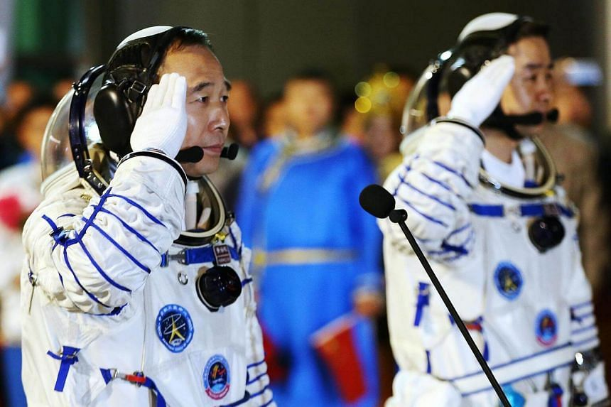 Chinese taikonauts Chen Dong (left) and Jin Haipeng salute during a farewell ceremony before the launch of the Shenzhou-11 spacecraft at the Jiuquan Satellite Launch Centre in Jiuquan in Gansu province, China.