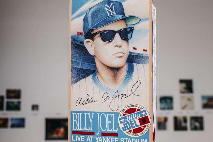 Memorabilia from a Billy Joel concert at Yankee Stadium on display at the symposium.