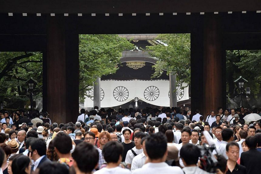 People visit the Yasukuni shrine in Tokyo on Aug 15, 2016, the 71st anniversary of Japan's surrender in World War II.