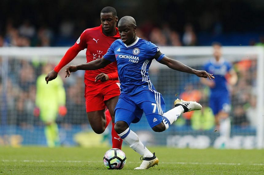 Chelsea midfielder N'Golo Kante (right) tussles for the ball against Leicester City's Jeff Schlupp during their EPL match on Oct 15, 2016.