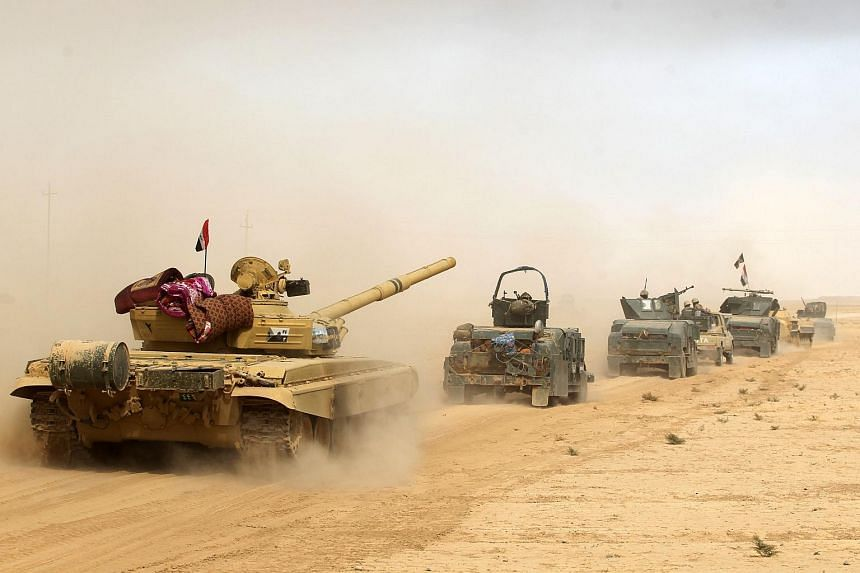 Iraqi forces deploying south of Mosul as they prepare for an offensive to retake the city from ISIS, on Oct 17, 2016.