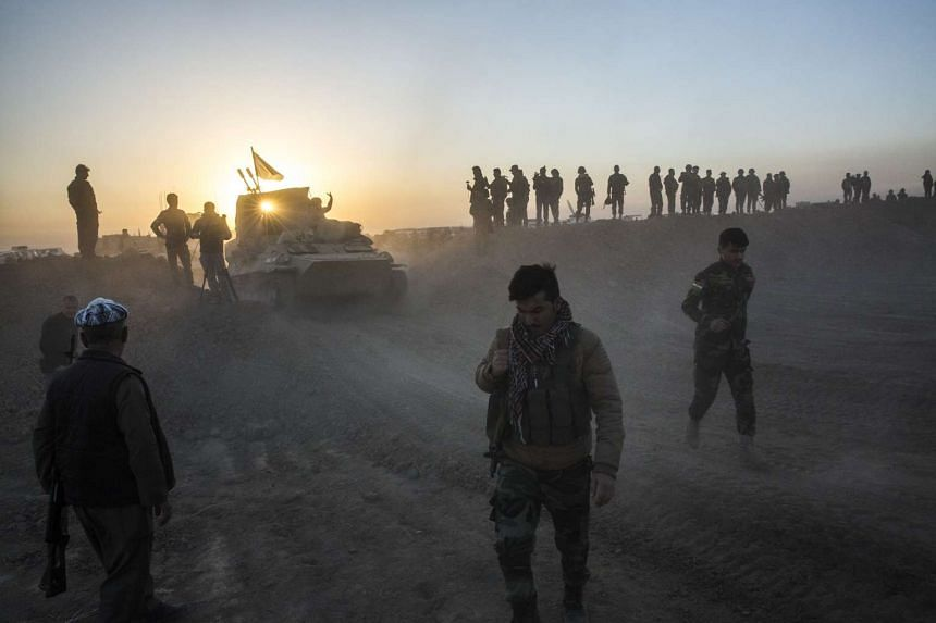 Kurdish forces advancing on a string of villages east of Mosul.