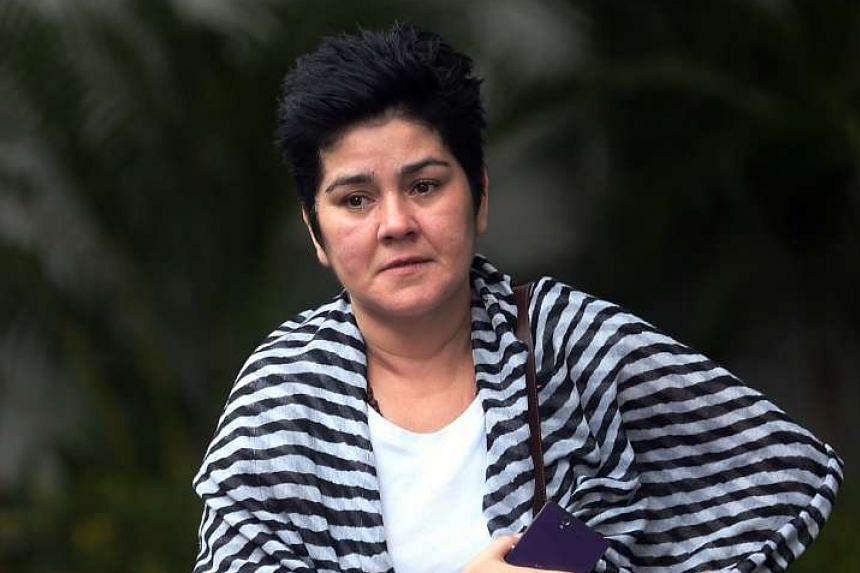 Paula Alexandra Aiyos Ribeiro, 45, bit a taxi driver and verbally abused him on Dec 17, 2015.