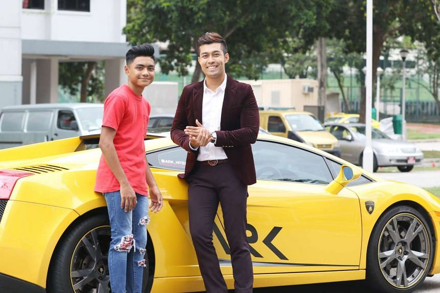 Teen mountain biker Izzadnaff Abdul Qusyairl (left) with the owner of the supercar, Mr Aaron Rylan Keder.