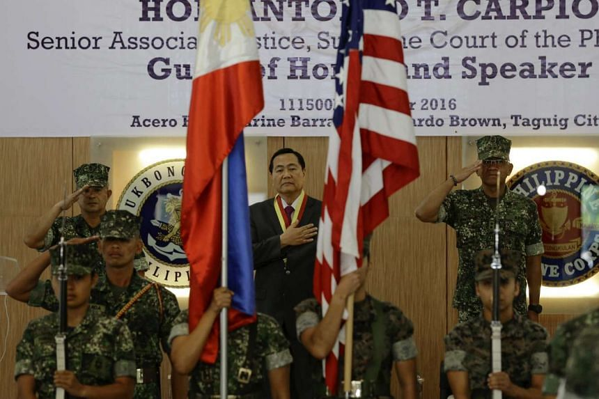 Philippine Senior Associate Justice Antonio Carpio (centre) stands during the closing ceremony for the joint Philippine-United States military exercise, in Taguig city on Oct 11, 2016.