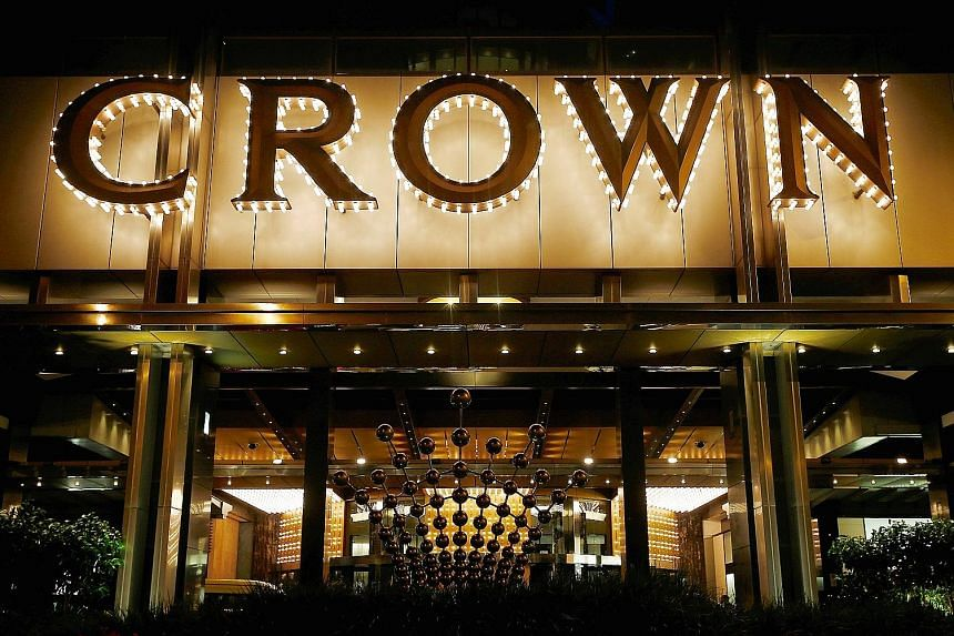 Left: Crown casino in Melbourne. Crown shares fell 14 per cent, their biggest one-day decline. Above: Billionaire James Packer, who owns 53 per cent of Crown Resorts. The company said it had not made contact with its 18 employees, including Australia