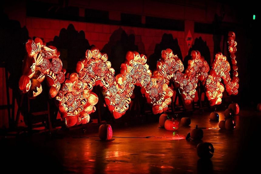"""A Chinese dragon made from illuminated pumpkins taking pride of place at the """"Rise of the Jack O'Lanterns"""" show in Los Angeles, California, over the weekend. The four-day show featured thousands of carved pumpkins ahead of Halloween, which is celebra"""