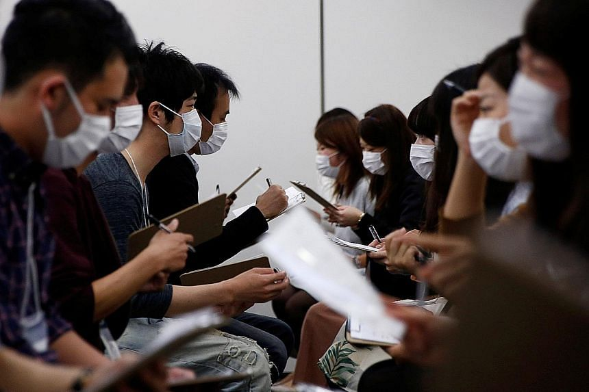 Looks are not everything. At least, that is what one Japanese dating service is trying to prove - by requiring participants in speed dating sessions to wear white surgical masks. Dating services are booming in Japan as young people brought up in the