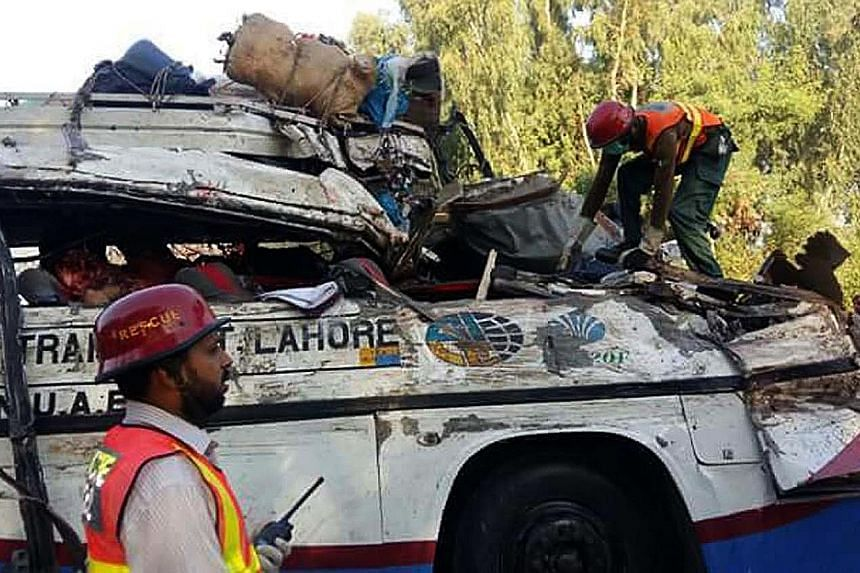 Rescue workers had to cut open the buses to extricate the bodies and injured passengers after the accident in Khanpur. The two buses, carrying about 100 passengers, collided head-on early yesterday.