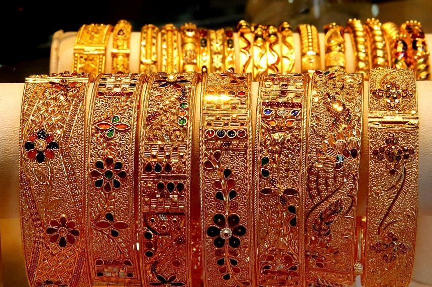 """Gold jewellery on display at a shop in Singapore. The solution being assessed is to hold an earlier auction in London to set """"pre-AM"""" prices at around 2pm Singapore time."""