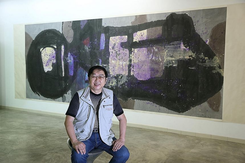 Lee Teck Suan with his largest work to date at the show, Beyond Babel, titled No. 1 Jing Shan Tian.