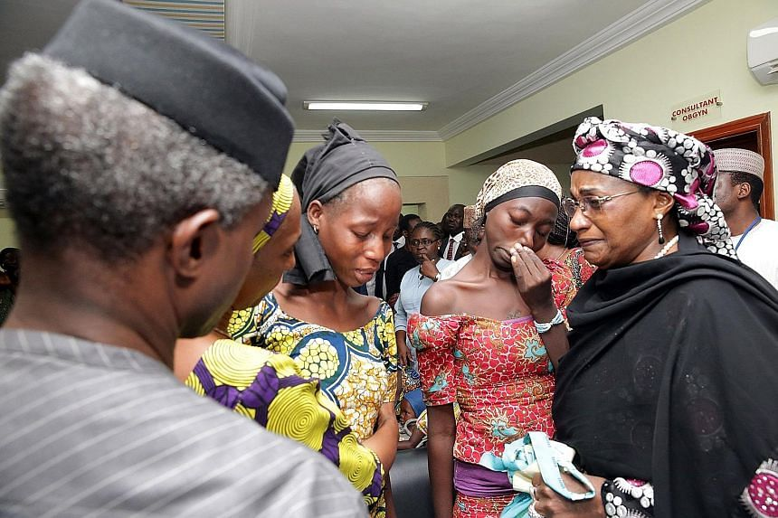 Some of the 21 released Chibok schoolgirls at a gathering in Abuja, Nigeria, last Thursday. As many as 276 girls were taken in April 2014 when Boko Haram militants stormed a boarding school.
