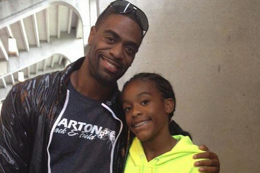 Olympic sprinter Tyson Gay with his daughter Trinity, who died after being caught in a shooting between two vehicles.