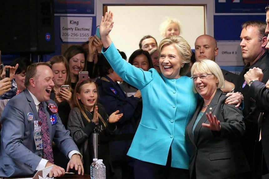 US Democratic presidential nominee Hillary Clinton greets people at a campaign office in Seattle, Washington.