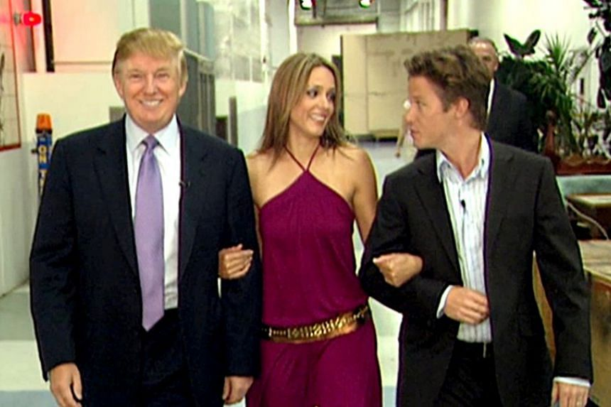 Billy Bush (right) with Donald Trump and actress Arianne Zucker before an appearance on Days Of Our Lives in 2005.