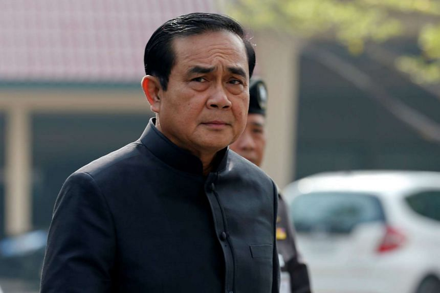 Thai Prime Minister Prayut Chan-o-cha arriving for his weekly Cabinet meeting dressed in black, in Bangkok on Oct 18, 2016.