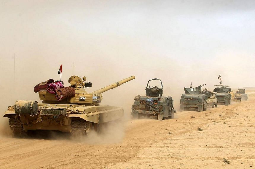Iraqi forces deploy in the area of al-Shurah, some 45km south of Mosul, as they advance towards the city to retake it from ISIS, on Oct 17, 2016.