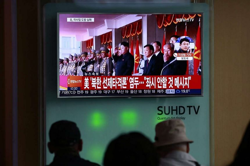 South Koreans watch a television news broadcast at a station in Seoul on Oct 16, 2016.
