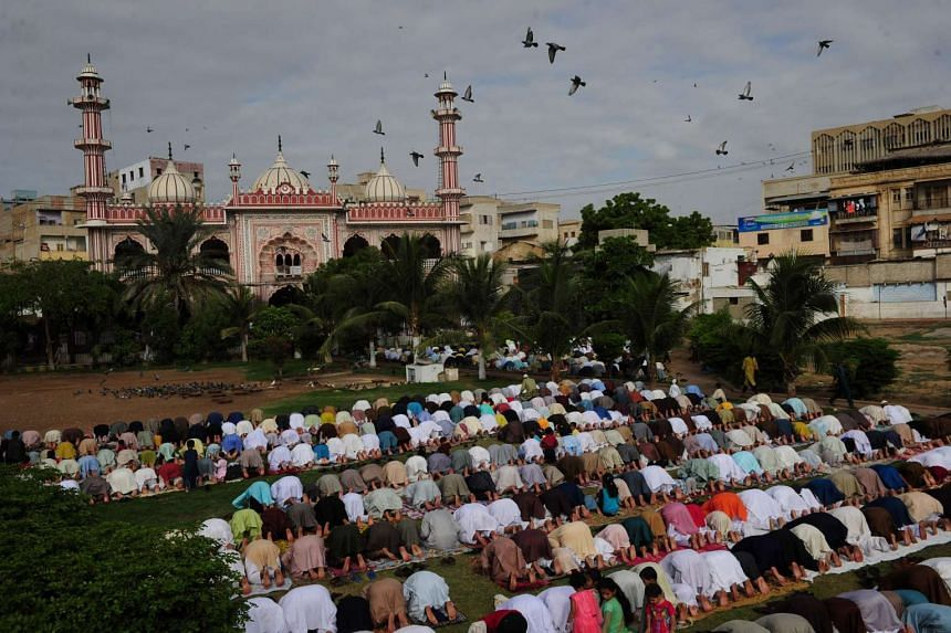 Pakistani Muslims offer Eid al-Adha prayers at a mosque in Karachi in September. A Shiite mosque came under attack on Monday, killing one teenager and injuring nine others.