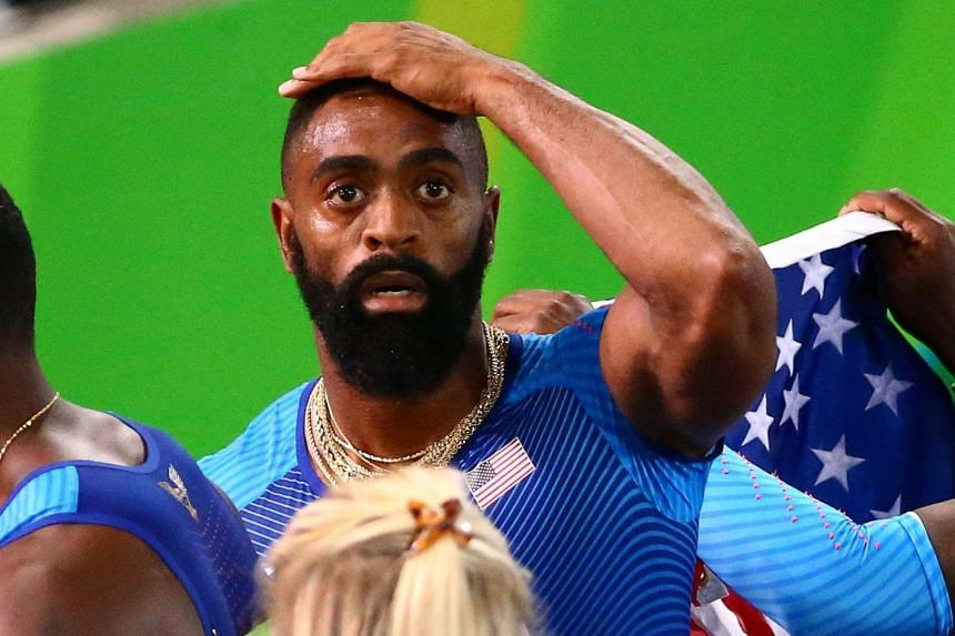 Three people including a father and son have been arrested by police investigating the shooting death of the daughter of United States Olympic sprinter Tyson Gay (above), police said on Monday.