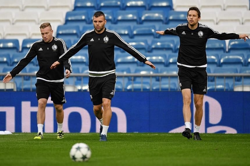 Legia Warsaw's players Thibeau Moulin (left), Nemanja Nikolic (centre) and Kasper Hamalainen (right) during the training held at Santiago Bernabeu stadium in Madrid, Spain on Oct 17, 2016.