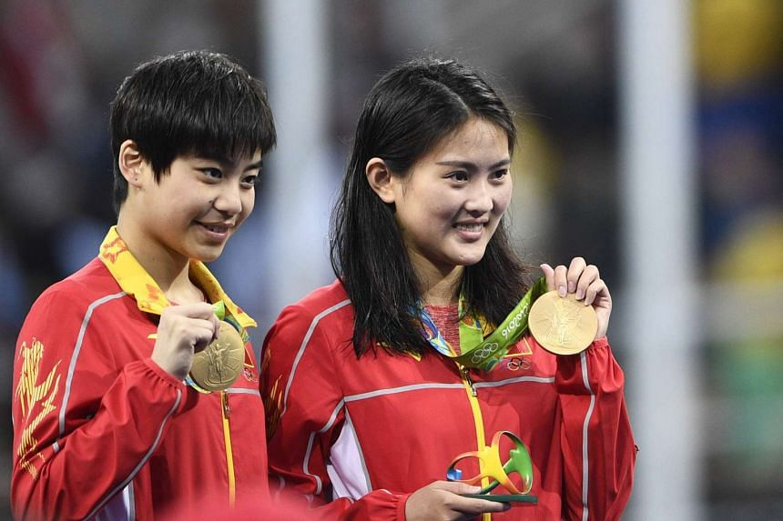 China's Chen Ruolin (right) and Liu Huixia posing with their medals after they won the  Women's Synchronised 10m Platform Final in Rio de Janeiro, on Aug 9, 2016.