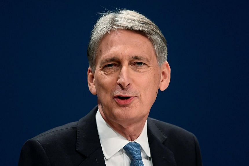 British Finance Minister Philip Hammond speaks at the Conservative Party conference in Birmingham on Oct 3, 2016.