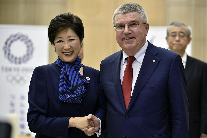 International Olympic Committee president Thomas Bach shake hands with Tokyo Governor Yuriko Koike at the start of their meeting in Tokyo on Oct 18, 2016.